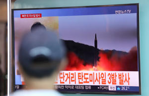 File: Man watches the news of North Korea test firing a ballistic missile. (AP Photo)