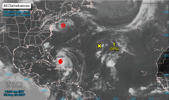 A low pressure system that has developed over the central Atlantic Ocean almost a thousand miles east-southeast of Bermuda has a 30 percent chance of developing into a cyclone over the next two days, the National Hurricane Center (NHC) said on Friday.