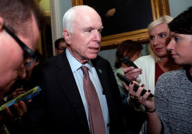 Sen. John McCain, R-Ariz., speaks with reporters before heading into a policy lu...