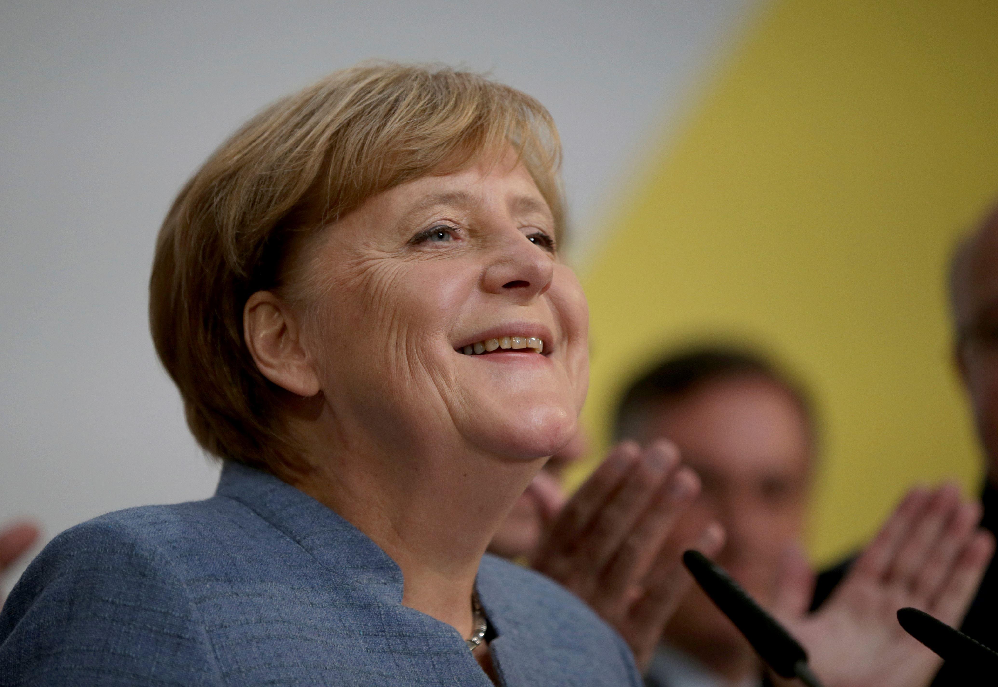Merkel wins 4th term but nationalists surge in German vote