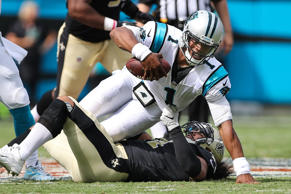 Carolina Panthers quarterback Cam Newton (1) is sacked during the second half of...