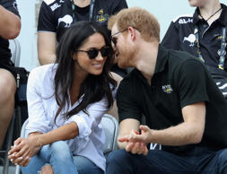 Prince Harry (R) and Meghan Markle (L) attend a Wheelchair Tennis match during the Invictus Games 2017 at Nathan Philips Square on September 25, 2017 in Toronto, Canada.