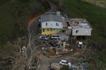 A damaged home is seen as people deal with the aftermath of Hurricane Maria.
