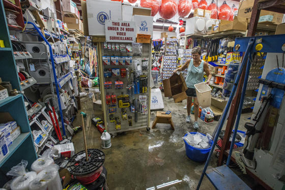 Slide 1 of 50: BAYOU LA BATRE, AL - OCTOBER 8:  Tara Marshall cleans up Marshall Marine after the store took three feet of storm surge from Hurricane Nate on October 8, 2017 in Bayou La Batre, Alabama.  Hurricane Nate made its second landfall along the north Mississippi Gulf Coast as a category 1 hurricane Sunday before weakening to a tropical storm.