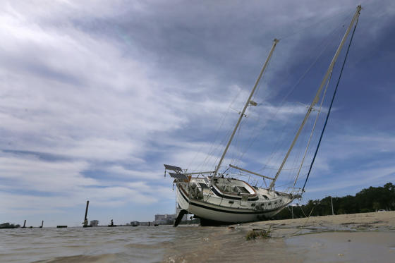 Slide 2 of 50: A sail boat is seen washed ashore after Hurricane Nate in Biloxi, Mississippi, U.S., October 8, 2017.
