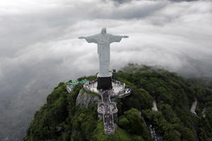 An aerial view of the famous Christ the Redeemer atop of Corcovado mountain in Rio de Janeiro, January 12, 2011. REUTERS/Bruno Domingos (BRAZIL - Tags: SOCIETY RELIGION TRAVEL IMAGES OF THE DAY)