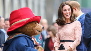 Kate dances with Paddington Bear at surprise charity appearance
