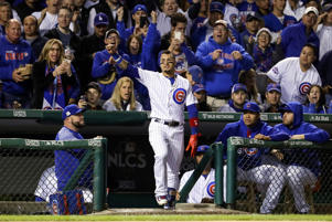 Javier Baez of the Cubs takes a curtain call after hitting a home run in the fifth inning against the Dodgers during game four of the NLCS at Wrigley Field on Oct. 18 in Chicago, Illinois.