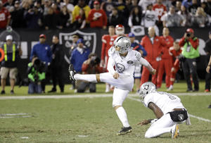 The Raiders' Giorgio Tavecchio (2) kicks the game winning point after try from the hold of Marquette King in Oakland, Calif., on Oct. 19. The Raiders won 31-30.