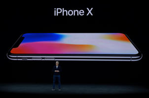 Apple CEO Tim Cook introduces iPhone X during the Apple launch event on September 12, 2017 in Cupertino,California.