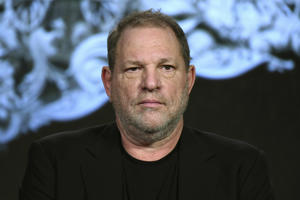"FILE - In this Jan. 6, 2016, file photo, producer Harvey Weinstein participates in a panel at the A&E 2016 Winter TCA in Pasadena, Calif. The Weinstein Co., mired in a sex scandal, may be putting itself up for sale. The company said Monday, Oct. 16, 2017, that it is getting an immediate cash infusion from Colony Capital and is in negotiations for the potential sale of all or a significant portion of the movie studio responsible for films like ""Shakespeare in Love,"" and ""Gangs of New York."""