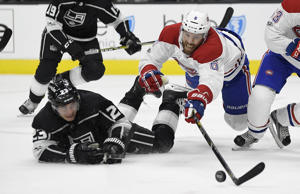 CAPTION: Montreal Canadiens defenseman Shea Weber, right, reaches for the puck along with Los Angeles Kings right wing Dustin Brown during the second period of an NHL hockey game, Wednesday, Oct. 18, 2017, in Los Angeles.
