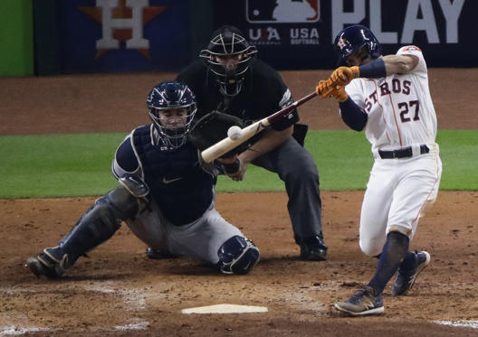 Slide 2 of 79: Houston Astros' Jose Altuve hits a home run during the fifth inning of Game 7 of baseball's American League Championship Series against the New York Yankees Saturday, Oct. 21, 2017, in Houston. (AP Photo/Charlie Riedel)