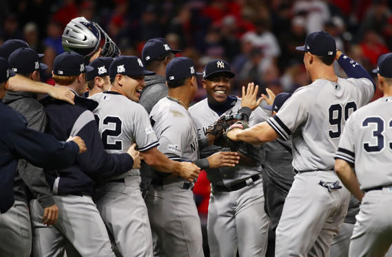 Slide 1 of 16: CLEVELAND, OH - OCTOBER 11:  Aroldis Chapman #54 of the New York Yankees celebrates with teammates after their 5 to 2 win over the Cleveland Indians in Game Five of the American League Divisional Series at Progressive Field on October 11, 2017 in Cleveland, Ohio.  (Photo by Gregory Shamus/Getty Images)
