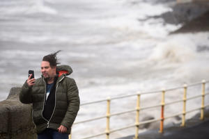 A man takes a selfie during storm Ophelia in the County Clare town of Lahinch