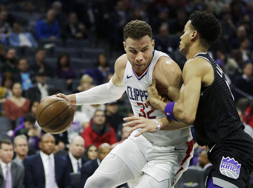 Slide 1 of 18: Los Angeles Clippers forward Blake Griffin, left, goes to the basket against Sacramento Kings forward Skal Labissiere during the first quarter of an NBA basketball game Thursday, Jan. 11, 2018, in Sacramento, Calif. (AP Photo/Rich Pedroncelli)