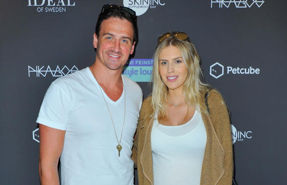 Slide 2 of 74: Olympic athlete Ryan Lochte (R) and Kayla Rae Reid attend Kari Feinstein's Pre-Oscar Style Lounge at the Andaz Hotel on February 23, 2017 in Los Angeles, California.