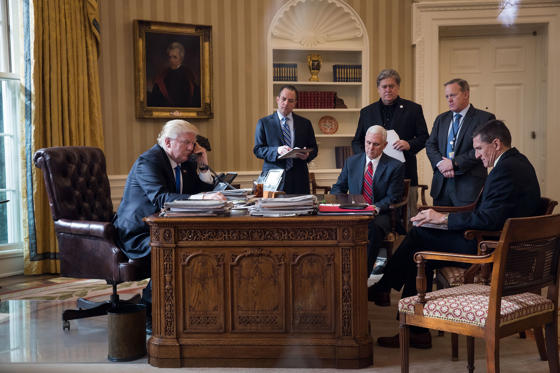 Slide 1 of 38: WASHINGTON, DC - JANUARY 28: President Donald Trump speaks on the phone with Russian President Vladimir Putin in the Oval Office of the White House, January 28, 2017 in Washington, DC. Also pictured, from left, White House Chief of Staff Reince Priebus, Vice President Mike Pence, White House Chief Strategist Steve Bannon, Press Secretary Sean Spicer and National Security Advisor Michael Flynn. On Saturday, President Trump is making several phone calls with world leaders from Japan, Germany, Russia, France and Australia. (Photo by Drew Angerer/Getty Images)