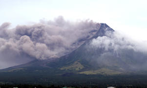 The Mayon volcano spews a column of ash during another mild eruption in Legazpi City, Albay province, south of Manila, Philippines January 16, 2018. REUTERS/Stringer NO RESALES. NO ARCHIVES