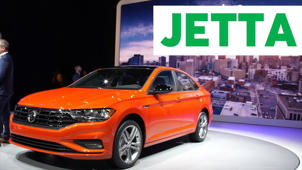 an orange car parked on the side of a road: 2018 Detroit Auto Show: 2019 Volkswagen Jetta
