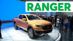 a man standing in front of a car: 2018 Detroit Auto Show: 2019 Ford Ranger Is Back