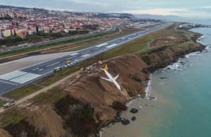 A Pegasus Airlines Boeing 737 passenger plane is seen struck in mud on an embankment, a day after skidding off the airstrip, after landing at Trabzon's airport on the Black Sea coast on Jan. 14, 2018.