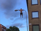 Man works out with a lamp post