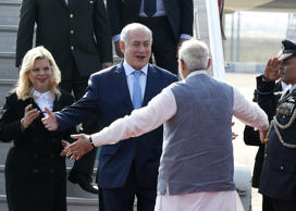 Prime Minister Narendra Modi (R) welcomes Israeli Prime Minister Benjamin Netanyahu (C) and his wife Sara Netanyahu (R) on their arrival at the Air Force Palam airport Station on January 14, 2018 in New Delhi, India.