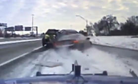 Tow truck driver narrowly avoids being crushed by out-of-control car