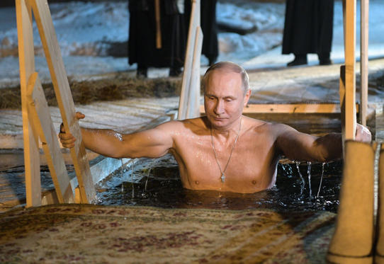 Slide 1 of 49: Russian President Vladimir Putin takes a dip in the ice cold water of Lake Seliger during the celebrations of the Epiphany Orthodox holiday at the Nilov Monastery on Stolobny Island in Russia, 19 January 2018.