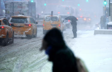 A man is seen during a snowstorm in New York, United States on January 04, 2018.