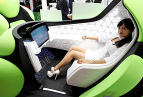 CAPTION: A model presents a one-seater mobility concept car Flesby, exhibited by Japan's auto parts maker Toyoda Gosei, during media preview of the 45th Tokyo Motor Show in Tokyo, Japan October 25, 2017. REUTERS/Kim Kyung-Hoon