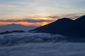 Sunrise taken from the top of Mount Batur (locally known as Gunung Batur), an active volcano on the Indonesian island of Bali.