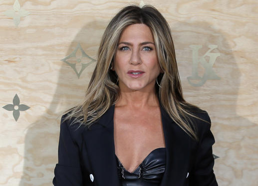 Slide 1 of 5: US actress Jennifer Aniston poses during a photocall ahead of a diner for the launch of a Louis Vuitton leather goods collection in collaboration with US artist Jeff Koons, at the Louvre in Paris, Tuesday, April 11, 2017.