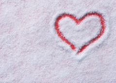 Snow background inside a red heart.