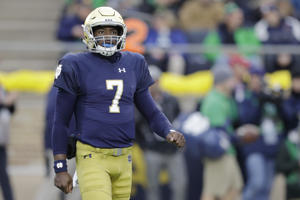 Notre Dame quarterback Brandon Wimbush (7) in action during the first half of an NCAA college football game against North Carolina State, Saturday, Oct. 28, 2017, in South Bend, Ind.