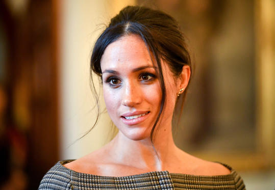 Slide 1 of 18: CARDIFF, WALES - JANUARY 18: Meghan Markle chats with people inside the Drawing Room during a visit to Cardiff Castle on January 18, 2018 in Cardiff, Wales. (Photo by Ben Birchall - WPA Pool / Getty Images)