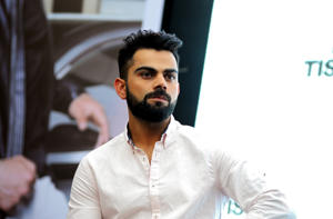 CAPTION: Indian international cricketer Virat Kohli looks on during a promotional event in Mumbai on March 13, 2018. / AFP PHOTO / - (Photo credit should read -/AFP/Getty Images)