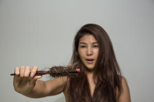 Young girl holding a hairbrush