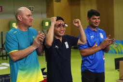 Shooting - Gold Coast 2018 Commonwealth Games - Men's 10m Air Pistol - Final - Belmont Shooting Centre - Brisbane, Australia - April 9, 2018. Gold medallist Jitu Rai of India celebrates flanked by silver medallist Kerry Bell and bronze medallist Om Mitharval. REUTERS/Eddie Safarik