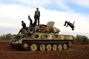 "Muhannad al-Kadiri (R),18, and Ibrahim Eid, 16, demonstrate their Parkour skills over a military vehicle in the rebel-held city of Inkhil, west of Deraa, Syria, February 4, 2017. REUTERS/Alaa Al-Faqir SEARCH ""PARKOUR"" FOR THIS STORY. SEARCH ""WIDER IMAGE"" FOR ALL STORIES."