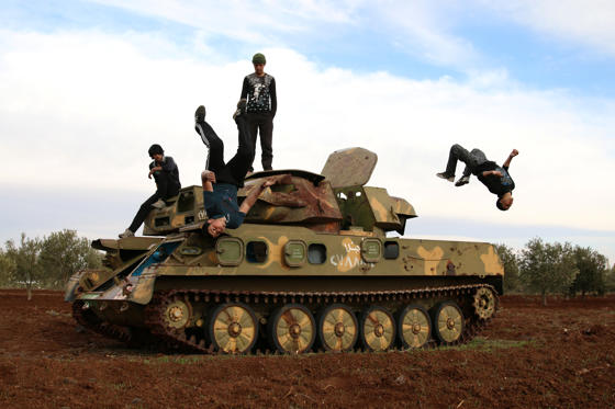 "Slide 1 of 21: Muhannad al-Kadiri (R),18, and Ibrahim Eid, 16, demonstrate their Parkour skills over a military vehicle in the rebel-held city of Inkhil, west of Deraa, Syria, February 4, 2017. REUTERS/Alaa Al-Faqir SEARCH ""PARKOUR"" FOR THIS STORY. SEARCH ""WIDER IMAGE"" FOR ALL STORIES."