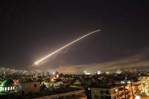 The Damascus sky lights up missile fire as the U.S. launches an attack on Syria targeting different parts of the capital early Saturday, April 14, 2018. Syria's capital has been rocked by loud explosions that lit up the sky with heavy smoke as U.S. President Donald Trump announced airstrikes in retaliation for the country's alleged use of chemical weapons.