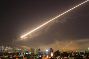 Damascus skies erupt with surface to air missile fire as the U.S. launches an attack on Syria targeting different parts of the Syrian capital Damascus, Syria