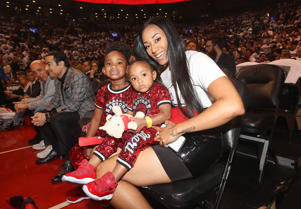 "Kiara Morrison the wife of DeMar DeRozan #10 of the Toronto Raptors poses for a photo with the couple""u2019s two daughters before the start of the game against the Washington Wizards prior to Game One of the first round of the 2018 NBA Playoffs at Air Canada Centre on April 14, 2018 in Toronto, Canada"