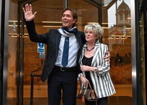 Sir Cliff Richard leaves the Rolls Building in London with Gloria Hunniford, where he gave evidence in a legal battle against the BBC.