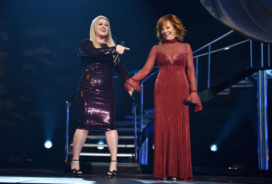 Slide 1 of 35: LAS VEGAS, NV - APRIL 15:  Kelly Clarkson (L) and Reba McEntire perform onstage during the 53rd Academy of Country Music Awards at MGM Grand Garden Arena on April 15, 2018 in Las Vegas, Nevada.  (Photo by John Shearer/ACMA2018/Getty Images for ACM)