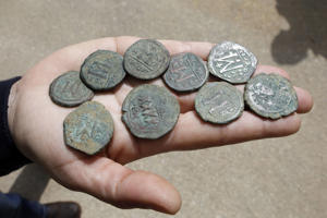 Archaeologist Annette Landes-Nagar, of Israel's Antiquities Authority, displays ancient coins from the era of the Byzantine Empire