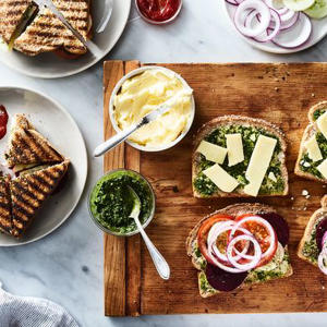 many different types of food on a table: Mumbai Vegetable Sandwich with Cilantro Chutney