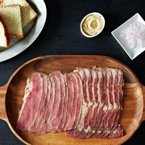 a plate of food on a table: Pastrami